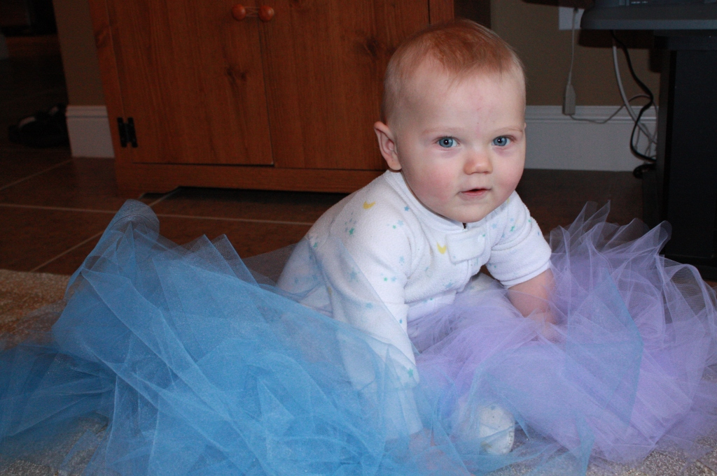 My baby boy crawling in the tulle